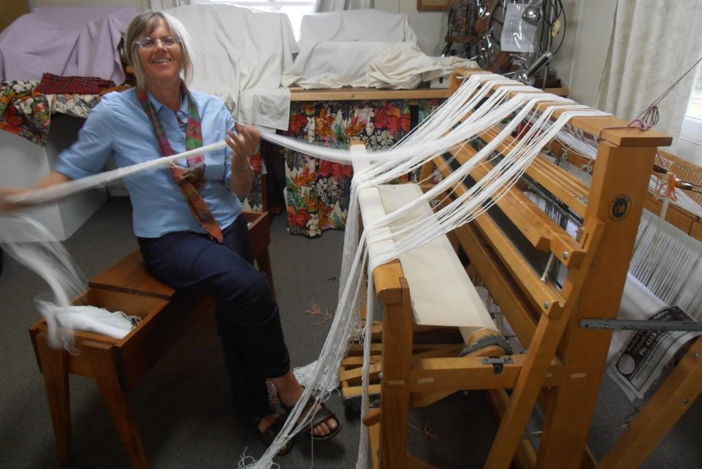 Margaret warping the big loom